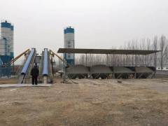 What is the difference between concrete mixing station and concrete mixing building